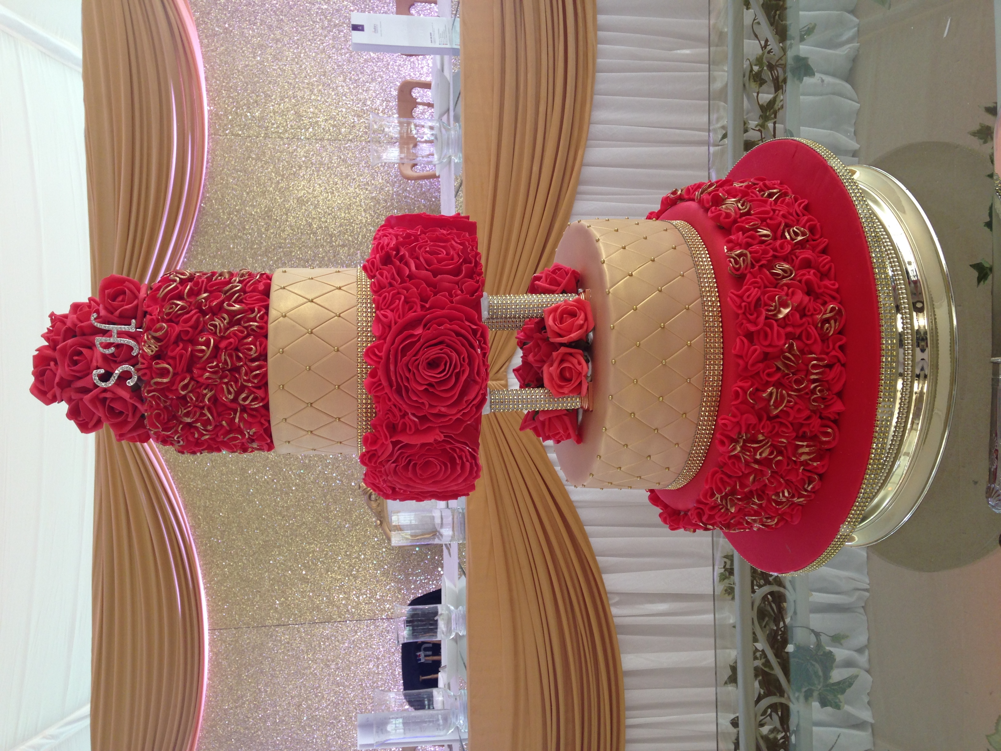 5 tier red gold wedding cake